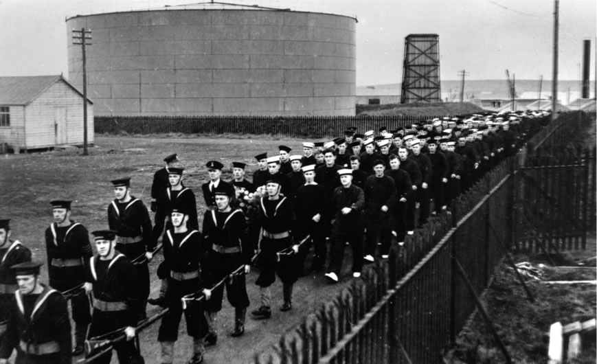 Royal Oak survivors marching up Canteen Road, Lyness © Orkney Library & Archive